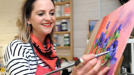 Artist, Lucy Perry, is pictured in her studio in Thorpe Morieux.