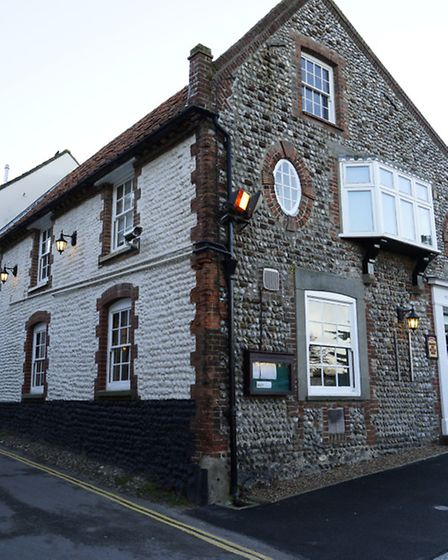 The flint walls of the White Horse Pub in Blakeney are typical of north Norfolk buildings