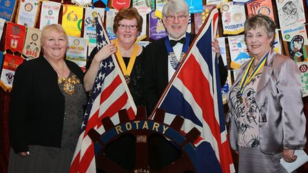 Rotary Club of Wigan President, Keith Trencher, and Vice-President, Maureen Bilsbrough, flanked by