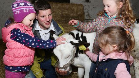 Lucy, Thomas, Beth and Jessica Noblet with 6 week old calf, Cinderella
