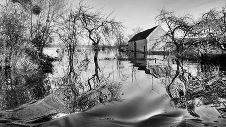 A flooded barn at Muchelney, 2014. From the book 'Under The Surface - Somerset Floods'