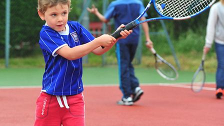 A young player tries his hand with a racket at last year's Great British Tennis Weekend at Beccles T
