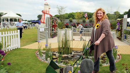 Charlie Dimmock in the show garden Bridging the Gap by Sharp Paving Ltd
