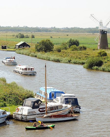 The view from the top of Thurne Mill looking along the River Thurne across the Broads landscape