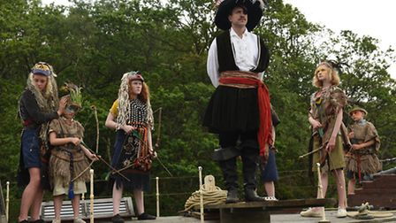 Captain Flint under guard by the Swallows and Amazons