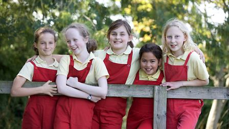 Some of the Knighton House pupils in their practical and distinctive red dungarees