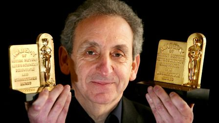 Mark with the two Oscars awarded for scientific and engineering