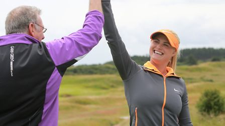 Steve Sealey won the 'nearest-the-pin' challenge and is congratulated by professional, Carly Booth (