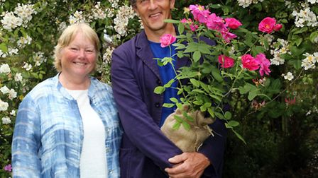 Maureen Little and Monty Don holding the red rose of Lancashire