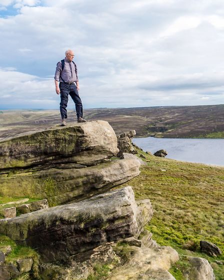 A walker takes in the stunning view from Gorple Stones