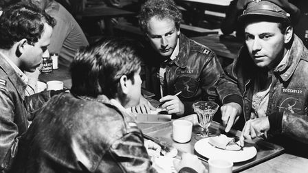 Art Garfunkel (centre) with Alan Arkin in Catch-22 (1970). Picture: Getty Images