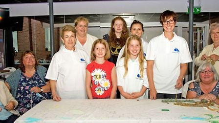 Community Collage makers Beth Trayner, Julie Trayner, Jean McLaughlin, Catherine Reid, Tilly Lord, E