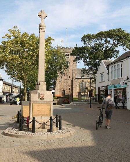 Poulton War Memorial and St Chad's Church in Poulton town centre