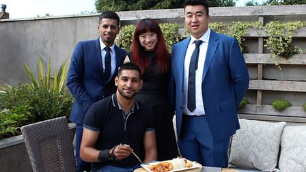 Amir Khan with the owners of The New Dhanak Deira