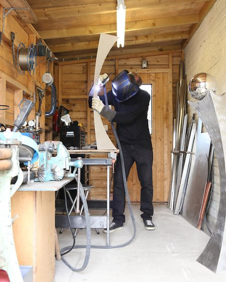 Steve James fabricating a sculpture in the workshop