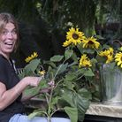 Actress Becky Hindley gathers the last of the years flowers in the garden near her Warton home. Milt
