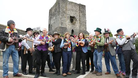 Clitheroe Ukulele Orchestra in front of Clitheroe Castle