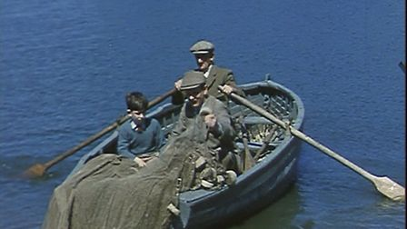 Prince Charles fishing on Holkham lake with a gamekeeper, 1957: from film footage shot by a member o