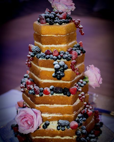 Bill and Dan's naked wedding cake. Photographs by Gordon Holmes
