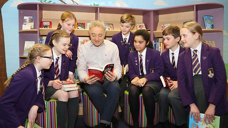 Frank Cottrell Boyce with pupils in the new library at Lytham Hall Park School