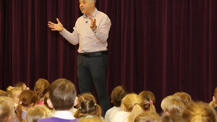 Frank Cottrell Boyce talks to pupils during assembly