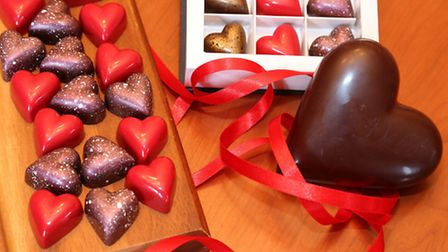 A melting chocolate heart with the Valentine's Chocolate Hearts Collection