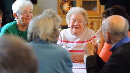 People with dementia, carers and volunteers enjoying the Pabulum Cafe at Wymondham Dementia Support