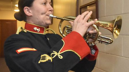 Band Lance Bombardier Catherine Line plays the Officers Mess Dinner Call.