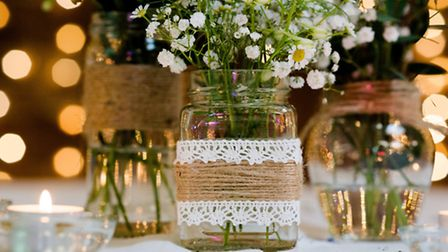 Our wonderful florist, Lucie, arrived juggling jam jars overflowing with pretty flowers for the tabl
