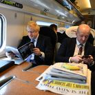 Boris Johnson, sitting with his Director of Communications, Lee Cain (right)