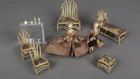 18th century quill or feather-work furniture, with a pair of fashionably-dressed 18th century dolls,
