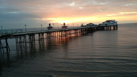 Starlings ready to roost at sunset, Blackpool North Pier by Annette Regan