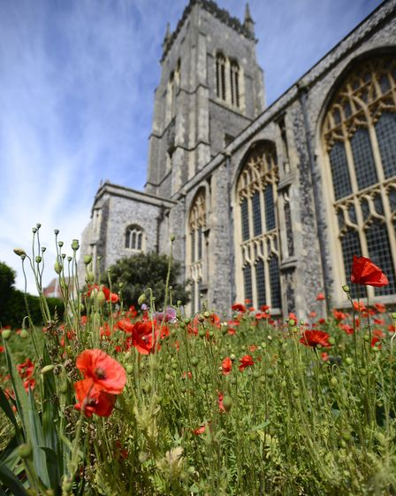 Poppies in the churchyard of Cromer Parish Church with St Martin's (picture: Mark Bullimore)