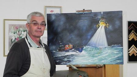 Trevor Loftus putting the finishing touches to his oil painting