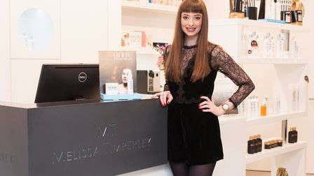 Melissa in the reception of her salon