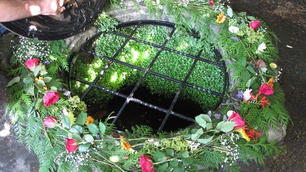 Chalice Well decorated for Beltane in May