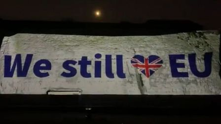 A message is projected on to the White Cliffs of Dover which reads 'we still <3 EU'. Photograph: Ant