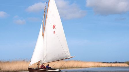 Rebel Reveller, one of Hunter's Yard's yachts, sails serenely on the Norfolk Broads near Ludham (pho
