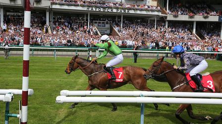 Emma streaks over the finish line at Haydock on I Am Not Here Photograph by John Grossick