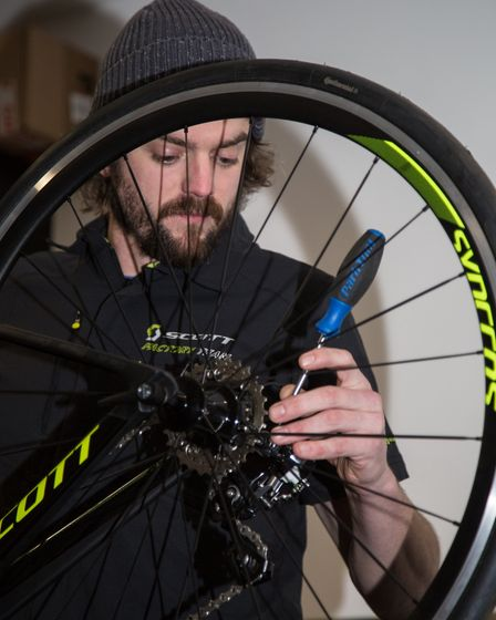 Simon Metcalfe working on a customised mountain bike in the workshop