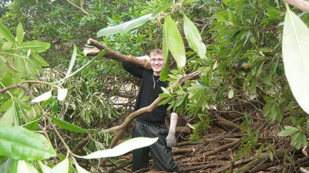 A volunteer at Littledale Hall in north Lancashire tackling rhododendron