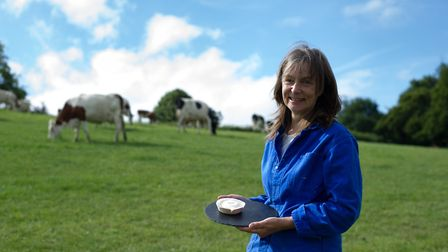 Julie Cheyney holds her St Jude at Fen Farm Dairy. Picture: SARAH LUCY BROWN