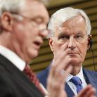Michel Barnier looks on as former Brexit secretary David Davis speaks in 2017