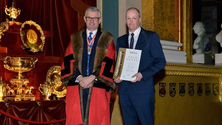 Rob Girling receives his gold award at the Goldsmiths Craft and Design Council from Boodles managing