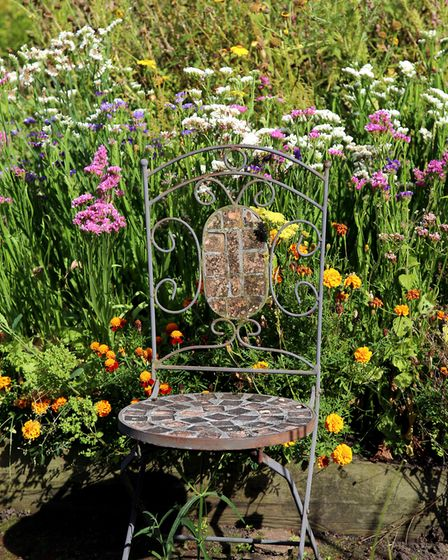 An attractive seat close by a border