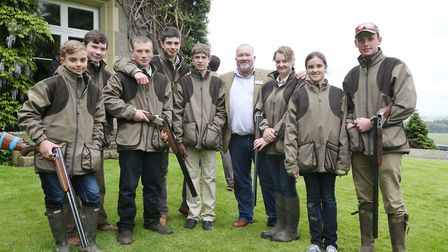 Duncan Thomas with a group of young shooters