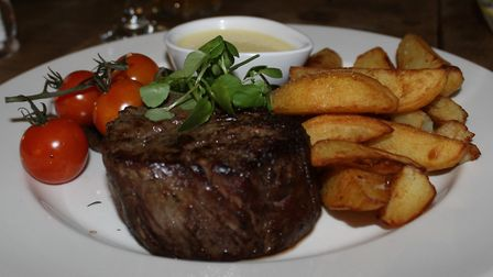 Fillet steak with hand cut chips, vine tomatoes and a blue cheese sauce