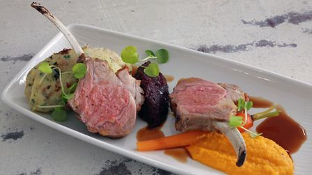Duo of lamb, red cabbage, new season carrots, red currant jus