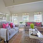 Sofas from Debenhams; pink cushions by Touche, try Zazzle.co.uk; coffee table, media unit, three sid
