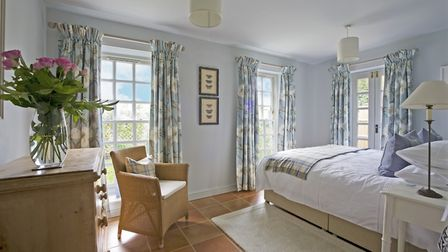 Sealy bed from Furniture Village; headboard from Laura Ashley; bedside tables and lamps from Furleys